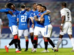 James Tavernier, centre, and Rangers celebrate their eighth goal (Jane Barlow/PA)