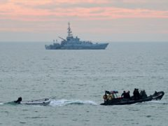 A small boat is towed by a Border Force vessel as Border Force Searcher (top) patrols the coastline following a small boat incident in the Channel earlier this morning (Gareth Fuller/PA)