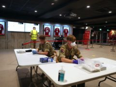 Members of the military use Anfield stadium as part of the mass testing taking place in the city of Liverpool (Peter Byrne/PA)