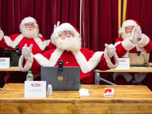 People dressed as Father Christmas at the Ministry of Fun's Santa School (Dominic Lipinski/PA)