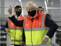 Boris Johnson, on a visit to a Tesco distribution centre in south-east London, has said everyone should be vaccinated (Kirsty Wigglesworth/PA)