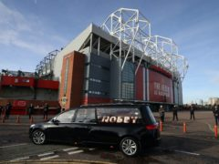 The hearse drove past Old Trafford before the service at Manchester Crematorium Southern Cemetery (Martin Rickett/PA)