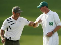 Paul Casey celebrates with his caddie John MacLaren after his opening 65 at the Masters (AP Photo/Matt Slocum)