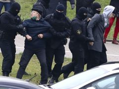 Belarusian riot police detain demonstrators during an opposition rally (AP Photo)