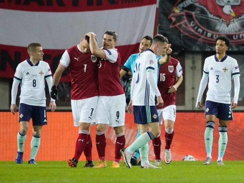 Austria scored two late goals to sink Northern Ireland in Vienna (Florian Schrotter/PA).