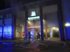 Firefighters extinguish a blaze in shops at a subway station in Berlin (Joerg Carstensen/dpa via AP)
