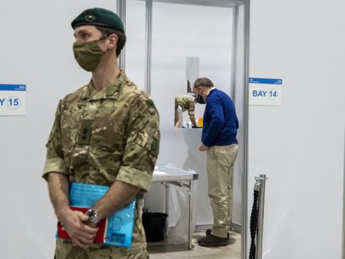 Defence Secretary Ben Wallace (right) during a visit to the Covid testing centre at Liverpool Exhibition Centre (Peter Byrne/PA)