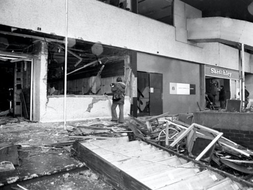 The aftermath of the Mulberry Bush pub bombing in Birmingham in November 1974 (PA)