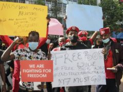 Ugandan supporters of opposition presidential candidate Bobi Wine protest his arrest and call for his release and an end to police brutality (AP)
