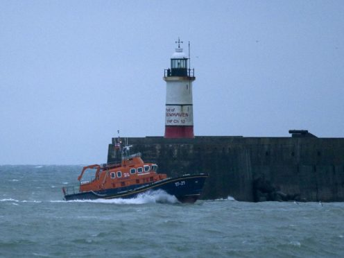 The RNLI severn class Lifeboat head to Newhaven harbour after searching for the missing two fishermen that went missing near Seaford, Sussex, when their fishing boat, Joanna C, sank off the coast near Seaford, East Sussex on Saturday.