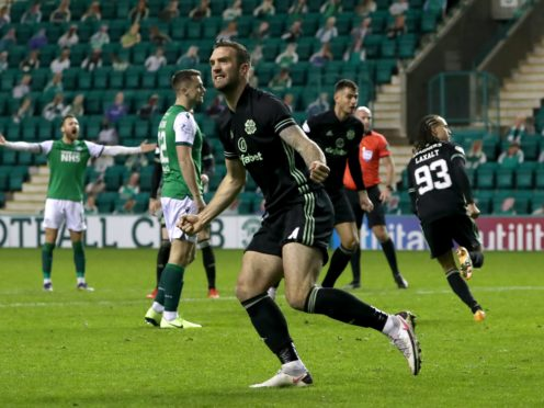 Shane Duffy celebrates Celtic's leveller scored by Diego Laxalt, background, at Hibs (Andrew Milligan/PA)