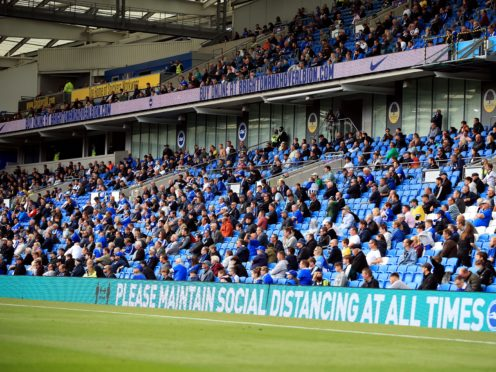 File photo dated 29-08-2020 of Brighton and Hove Albion fans adhering to social distancing.
