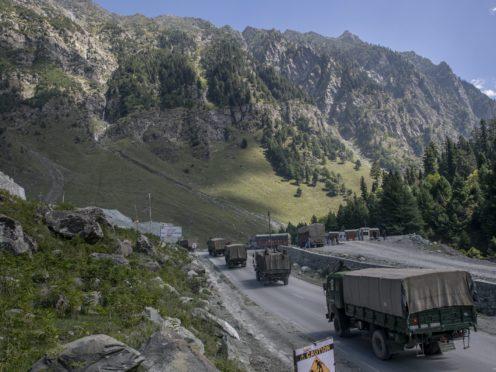 An Indian army convoy moves on the Srinagar- Ladakh road at Gagangeer, northeast of Srinagar (Dar Yasin/AP)