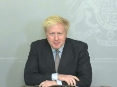 Prime Minister Boris Johnson speaks via video link from 10 Downing Street during Prime Minister's Questions in the House of Commons, London. Mr Johnson is self-isolating after coming into contact with an MP who has since tested positive for coronavirus (PA)