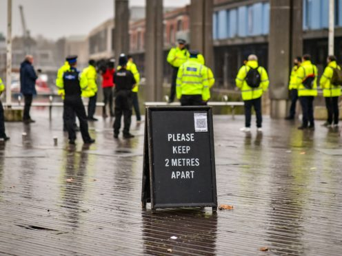 Police officers and Bristol Council Covid marshals meet in the city centre for a briefing during a day of action to reinforce coronavirus lockdown regulations (Ben Birchall/PA)