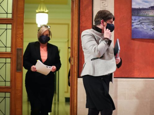 First Minister Arlene Foster, right, and Deputy First Minister Michelle O'Neill arrive for a press conference at Parliament Buildings, Stormont (Kelvin Boyes/Press Eye/PA)