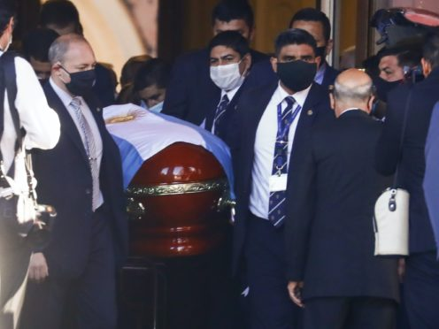The flag-draped casket of Diego Maradona is carried to a waiting hearse (Marcos Brindicci/AP)