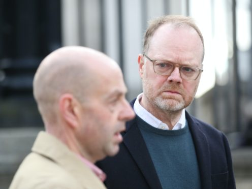 Barry McCaffrey, left, and Trevor Birney have won significant damages from the PSNI (Peter Morrison/PA)