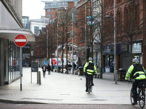 Belfast city centre was quiet on Friday as the two-week circuit-breaker began (Peter Morrison/PA)
