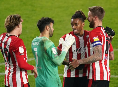 Ivan Toney, centre right, celebrates with team-mates after the final whistle (John Walton/PA)