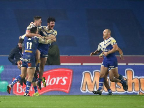 St Helens Jack Welsby (top left) celebrates scoring the winning try (Martin Rickett/PA)