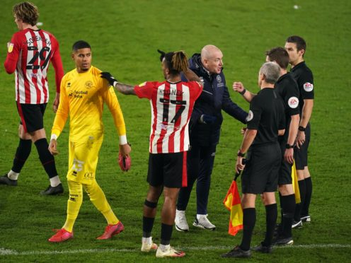 Mark Warburton, centre right, addresses the match officials after the final whistle (John Walton/PA)