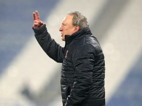 Neil Warnock's side lost 3-2 at Huddersfield (Mike Egerton/PA)