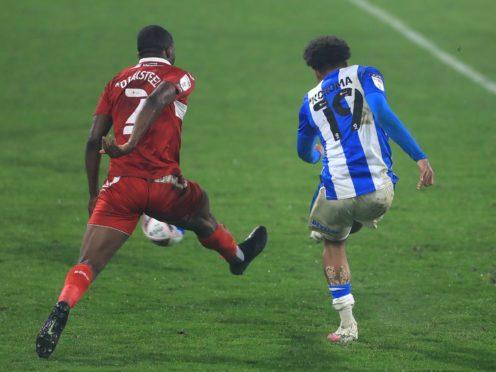 Huddersfield's Josh Koroma strikes the ball to score his side's winner.