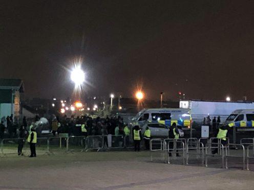 Fans gather outside Celtic Park to protest against manager Neil Lennon (PA)