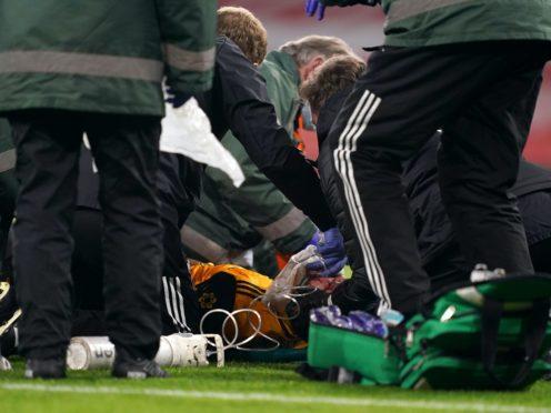 Raul Jimenez receives treatment on the pitch at the Emirates (John Walton/PA)