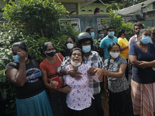 A family member of an inmate cries demanding the authorities reveal the condition of her relative (AP/Eranga Jayawardena)