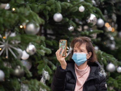 Scots are being urged to 'think carefully' before making plans this Christmas (Dominic Lipinski/PA)