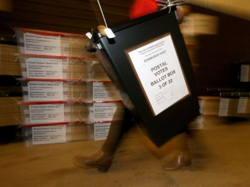 MSPs are seeking assurances there will be 'sufficient resources' for postal voting in next year's Holyrood election (Andrew Milligan/PA)