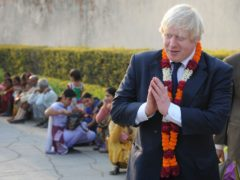 Boris Johnson visits the Akshardham Temple in New Delhi, a sister temple to the Neasden Temple in North West London, during a previous tour of India (Stefan Rousseau/PA)