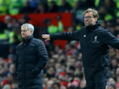 Jose Mourinho, left, and Jurgen Klopp are vying to be first in the Premier League (Martin Rickett/PA)