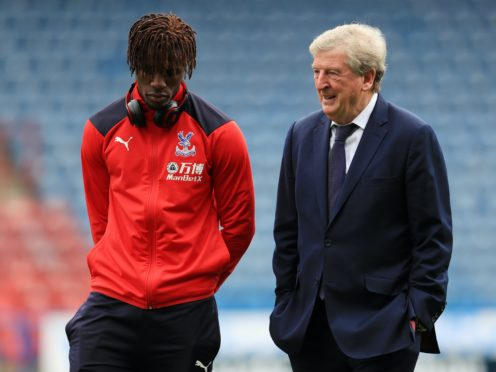 Roy Hodgson is pleased Crystal Palace will have Wilfried Zaha back for the trip to West Brom (Mike Egerton/PA)