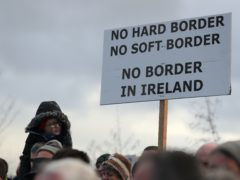People take part in an anti-Brexit rally at the Irish border near Carrickcarnan, Co Louth, (Brian Lawless/PA)