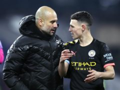 """Pep Guardiola (left) feels Phil Foden (right) needs to """"slow down"""" in his play at times (Martin Rickett/PA)"""