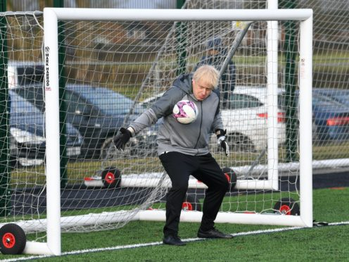 Boris Johnson tries out as a goalkeeper on the 2019 General Election campaign trail in December 2019 (Stefan Rousseau/PA)