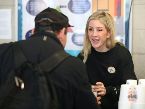 Ellie Goulding serves coffee to a guest while volunteering at a Crisis Christmas centre in London, as the charity opens its doors to homeless people for the festive period.