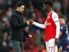Arsenal manager Mikel Arteta (left) has been impressed with the development of Bukayo Saka (Bradley Collyer/PA)