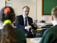 Education Minister Peter Weir said schools in Northern Ireland will deliver remote learning in the first week of the new term amid spiralling Covid infections (Liam McBurney/PA)