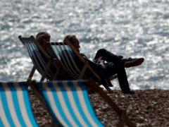 A couple enjoy the beach in Brighton. The typical premium to buy a home with a sea view has surged by more than £19,000 over the past year, as demand for coastal properties has been boosted during lockdown, according to Rightmove (PA)