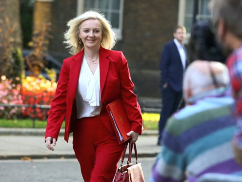 Liz Truss said the Government plans to negotiate a more ambitious trade deal at a later point. (Aaron Chown/PA)