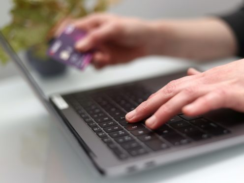 A new campaign will remind consumers to be aware of online scammers who swindled an average of £775 from each victim last Christmas (Tim Goode/PA)