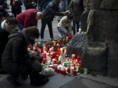 Mourners leave candles and flowers in tribute near the scene of the incident (Harald Tittel/dpa via AP/PA)