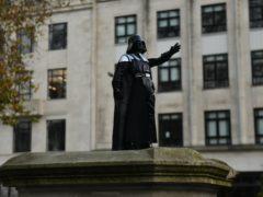A Darth Vader figurine on the empty Edward Colston plinth in Bristol (Jacob King/PA)