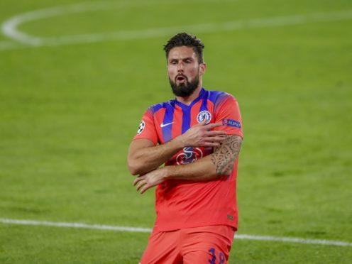 Olivier Giroud stole the show against Sevilla (Angel Fernandez/AP)