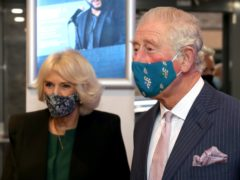 The Prince of Wales and Duchess of Cornwall, wearing masks, during a visit to the Soho Theatre in London (Chris Jackson/PA)