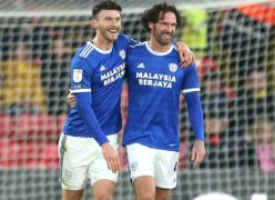Cardiff striker Kieffer Moore (left) celebrates his first-half matchwinner against Watford with team-mate Sean Morrison (Steven Paston/PA Images).